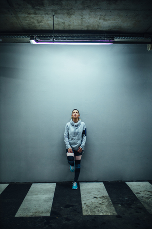 Full length portrait of an athlete woman.