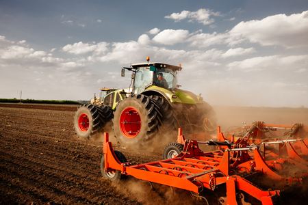 plowing: Preparing farmland with seed for next year. Stock Photo