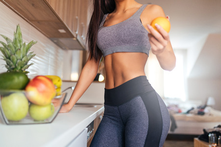 Cropped shot of young woman eating fruit for breakfast. Stock Photo