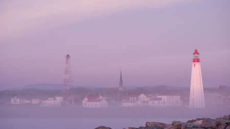 Pointe-Au-Père lighthouse in the mist in the city of Pointe-au-Père, near Rimouski, Quebec, Canada