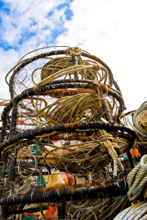 crab pot: Crab pot stacking together on a bright sunny day against beautiful blue sky