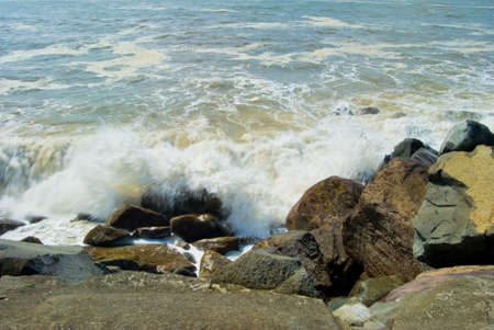 Wave Crushing Onto Jetty Rock in Ocean Shores, Washington photo