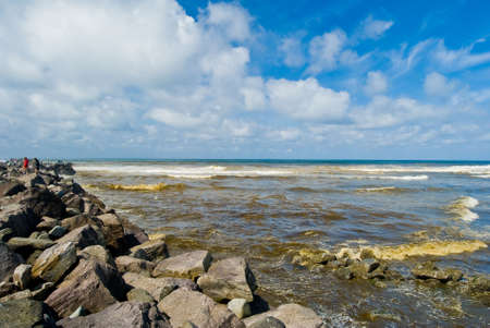 Ocean Shore Beach Scenery On A Bright Sunny Day Against Beautiful Blue Sky photo