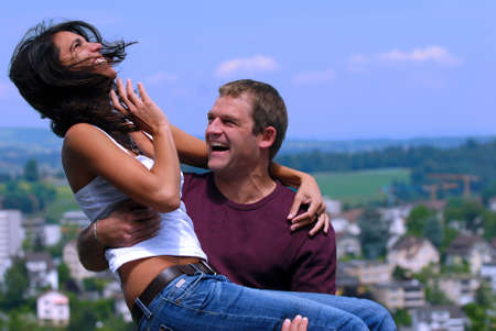 A couple in love happily fooling around. photo