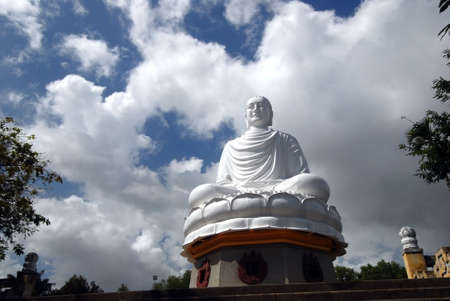 far east: Sitting buddha statue photographed on a hilltop in Nha Trang, Vietnam. Stock Photo