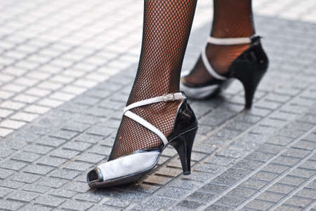 Feet of a woman in tango outfit posing for the cameras