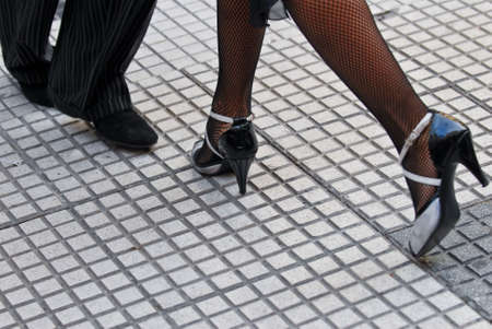 to sway: Feet of a couple dancing Tango in Buenos Aires.