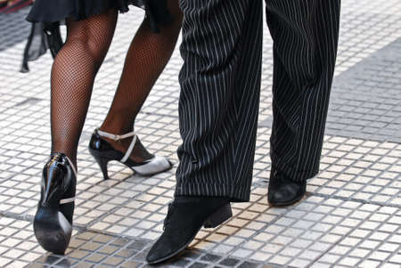 Feet of a couple dancing Tango in Buenos Aires. photo