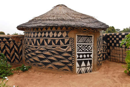 Adboe hut  in Tiebele, Burkina Faso with traditional tribal painting photo
