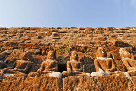 attainment: Row of stone buddha  statues at a temple in Mrauk U, Myanmar (Burma)