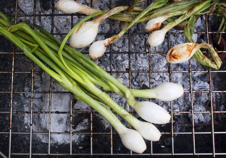 Photograph of some onions on a hot grill
