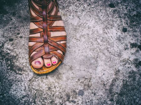 Photograph of a womans foot with a sandal