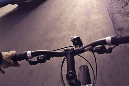 bike cover: Photograph of an urban cyclist real view of the street Stock Photo