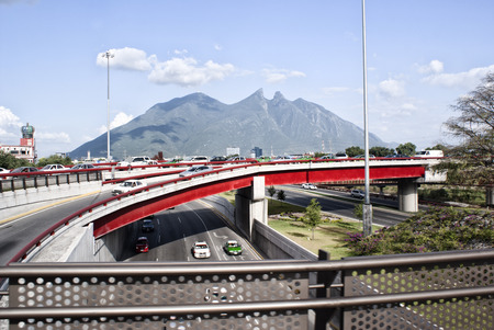 characteristic: Photograph of the city of Monterrey Mexico and its characteristic Cerro de la Silla mountain