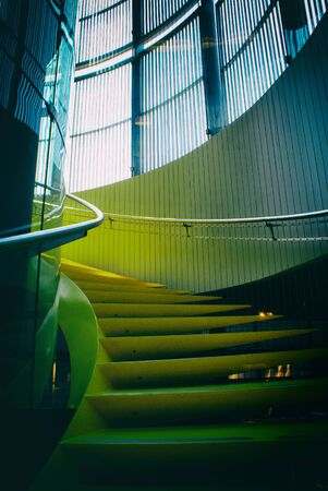 Photograph of  a metal yellow abstract stairs