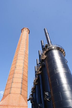 metal structure: Photograph of an industrial metal structure and a brick tower