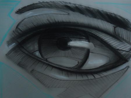 Photograph of a hand drawn human eye charcoal sketch