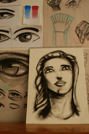 Photograph some hand drawn sketches of a womans face hands and eyes Stock Photo