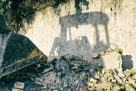 loader: Photograph of an end loader construction machine shadow Stock Photo