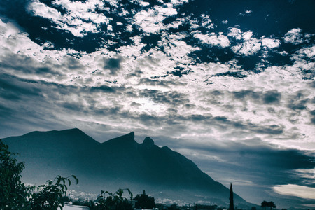 Photograph of a mountain and a cloudy sky. The Cerro de la Silla mountain in the city of Monterrey Mexico Reklamní fotografie - 48823065