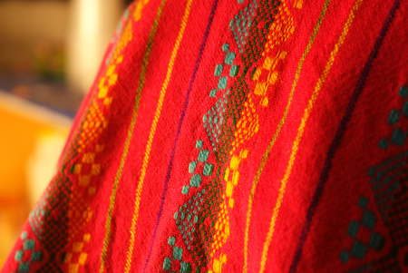 indigenous: Photograph of an Indigenous ethnic red fabric
