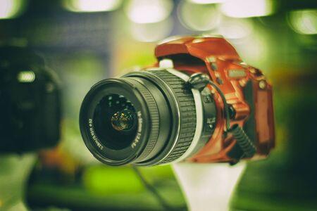 reflex: Photograph of a red reflex camera on a blurred background