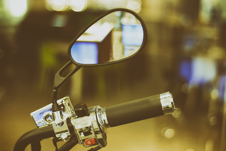 accelerator: Photograph of a motorcycle side mirror and handlebar Stock Photo