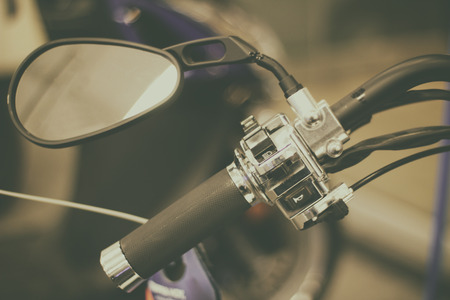 Photograph of a motorcycle side mirror and handlebar Stock Photo