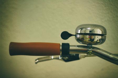 handlebar: Photograph of a bicycle handlebar and bell