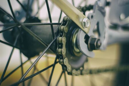 spokes: Photograph of a bicycle chain and spokes closeup and blurred background Stock Photo