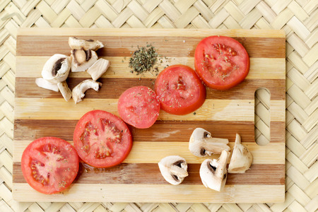 Photograph of a wood cutting board with vegetables Imagens - 55421076