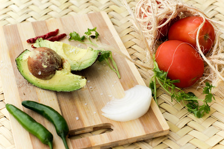 Photograph of a wood cutting board with vegetables Imagens - 55421691