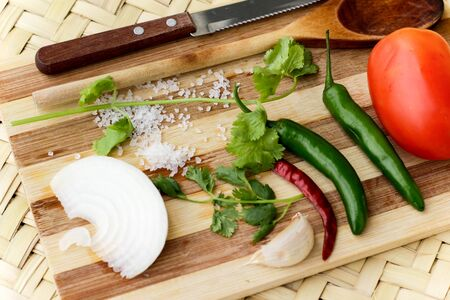 Photograph of a wood cutting board with vegetables Imagens - 55421701