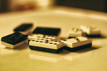 Photograph of some black and white dominoes on a table