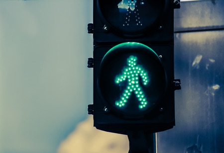 Photograph of a traffic light on urban scenario Stock Photo