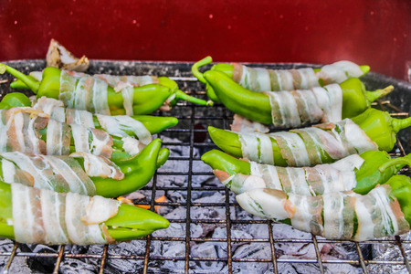 Photograph of sone green chilis rolled in bacon