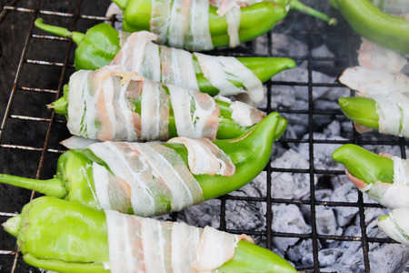 sone: Photograph of sone green chilis rolled in bacon