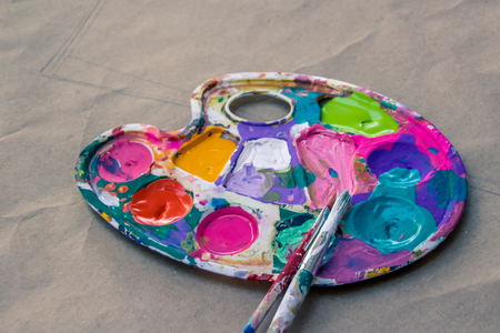 color photographs: Photograph of an art palette with paint and brushes Stock Photo