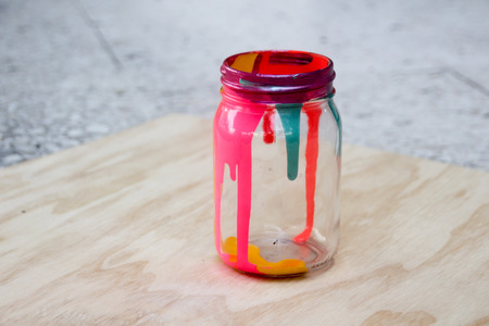 Photograph of a colorful cristal bottle with dripped paint inside