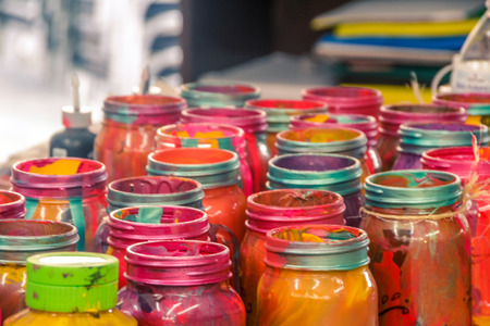 Photograph of some colorful cristal bottles with paint