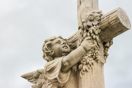 sculpted: Photograph of an Angel and religious Cross sculpted statue