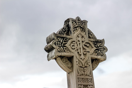 sculpted: Stone religious sculpted Cross with symbols