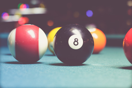 Photograph of some billiards plastic balls on table Stock Photo