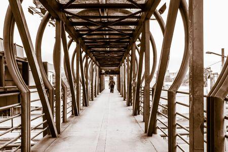 pedestrian bridge: Photograph of a metal pedestrian bridge Stock Photo