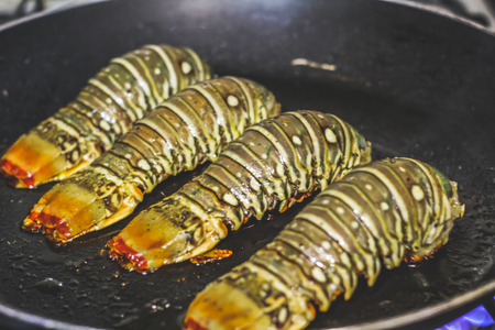 Photograph of four lobster tails ready to eat