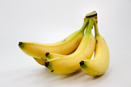 Photograph of some bananas on white background