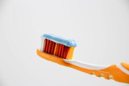 Photograph of a toothbrush with toothpaste Banco de Imagens