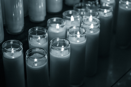 Photgraph of some lighted wax candles Stock Photo