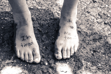 Photograph of a pair of human feet and the phrase: Im tired, me too