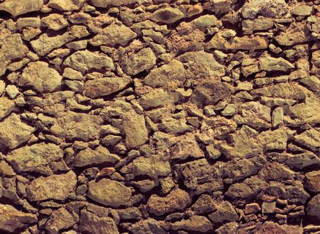 Photograph of a stone wall texture or background